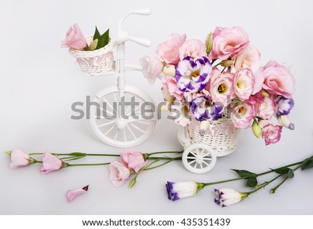 fresh flower bouquet in a decorative white carriage