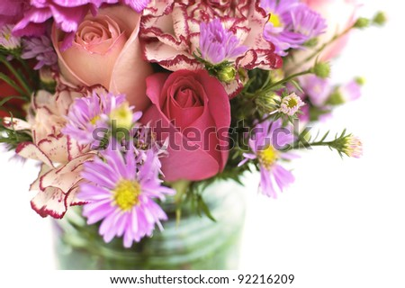 Fresh Flower Bouquet in a Glass Jar - stock photo