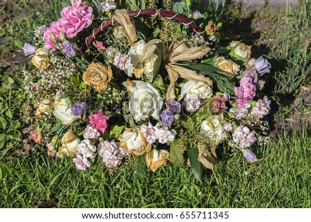 Fresh flowers dried in a basket on the lawn.