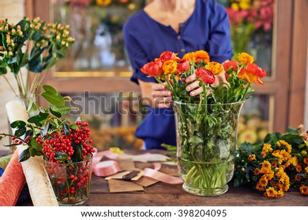 Fresh flowers in vase - stock photo