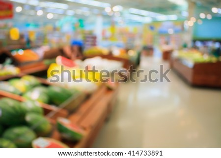 Fresh food in supermarket store blurred background with bokeh - stock photo