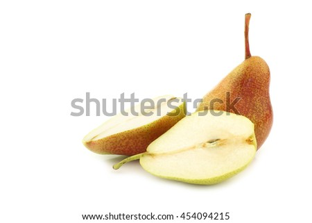 "fresh ""Forelle"" pear and a cut one on a white background - stock photo"