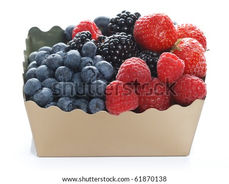 Fresh forest berries in golden box on white background - stock photo