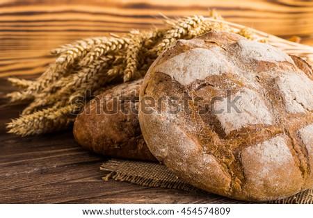 Fresh fragrant bread on the table. - stock photo