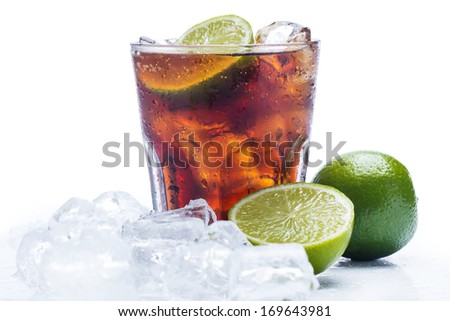 Fresh Fresh cocktail with cola drink and lime fruit - stock photo