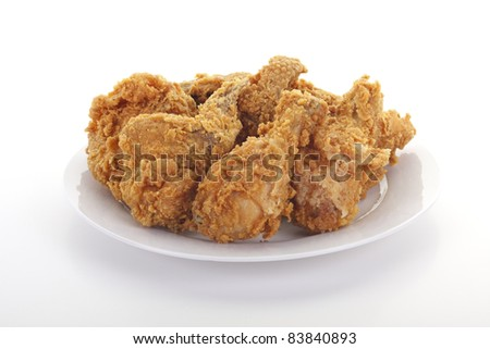 Fresh fried chicken on a white plate - stock photo
