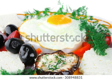 fresh fried egg served on white plate with vegetables - stock photo