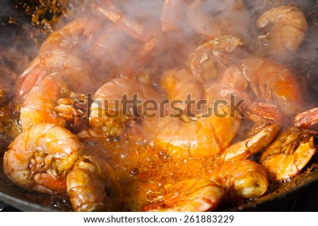 fresh fried shrimps with smoke - stock photo
