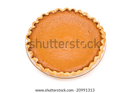Fresh from my oven.  Home made pumpkin pie on white background. - stock photo