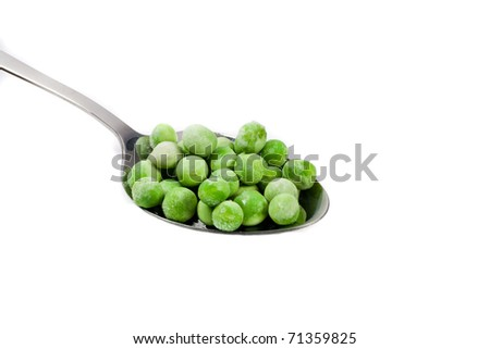 fresh frozen green peas on spoon on white - stock photo