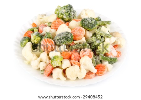 Fresh frozen vegetables on a white background