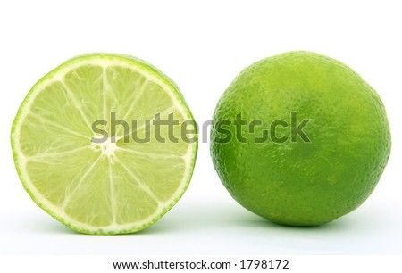 Fresh fruit, a tropical green lime macro closeup, isolated on white, close-up with copyspace - stock photo