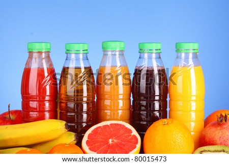 fresh fruit and juices on a blue background