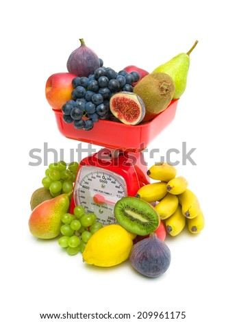 fresh fruit and kitchen scales close up on a white background. vertical photo. - stock photo