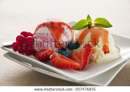 Fresh fruit and vanilla ice cream close up - stock photo