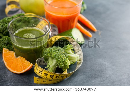 Fresh fruit and vegetable juice in the glass for detox, selective focus - stock photo