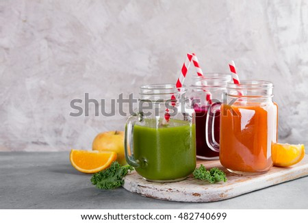 Fresh fruit and vegetable juice in the glass mason jar for detox or healthy lifestyle, selective focus