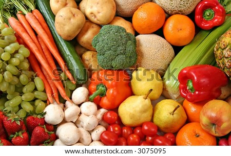 Fresh fruit and vegetable variety, water droplets visible at 100%. - stock photo