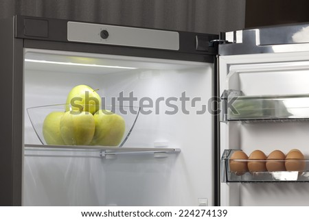 fresh fruit and vegetables in the fridge - stock photo