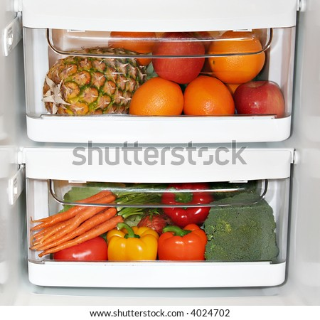 Fresh fruit and vegetables in the fridge. - stock photo