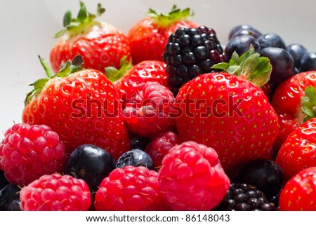 Fresh fruit close up of strawberries and raspberries - stock photo