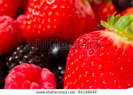 Fresh fruit close up of strawberries and raspberries