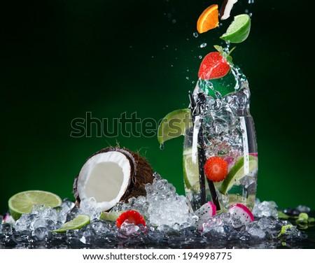 Fresh fruit cocktail in freeze motion splashing, close-up. - stock photo
