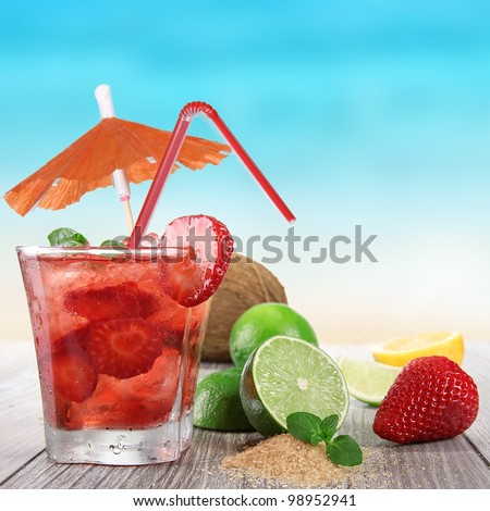Fresh fruit drink on a beach - stock photo
