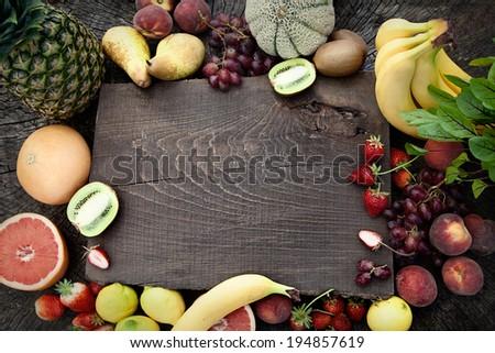 Fresh fruit. Fruit variety on wood. Food background. Tropical fruit - stock photo