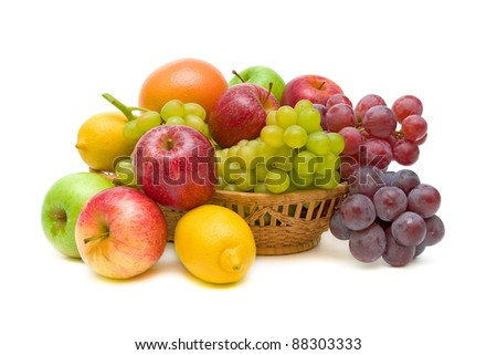 fresh fruit in a basket isolated on white close-up - stock photo