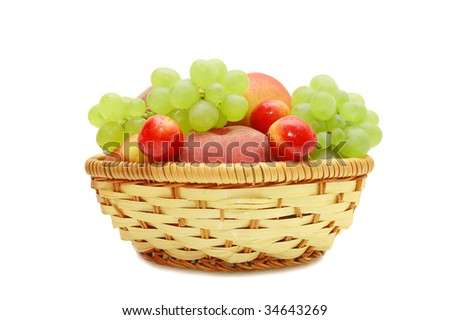 Fresh fruit in a wattled basket on a white background