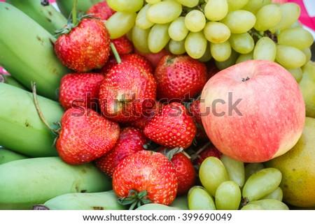 Fresh fruit in season, strawberry, apple, banana, grape - stock photo