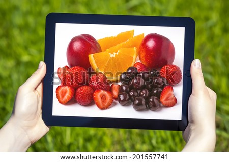 fresh fruit in tablet display - stock photo