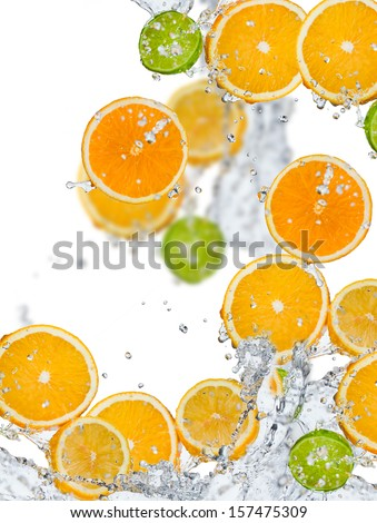 Fresh fruit in water splash  - stock photo
