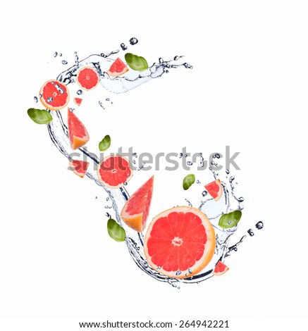 Fresh fruit in water splash, falling grapefruit - stock photo