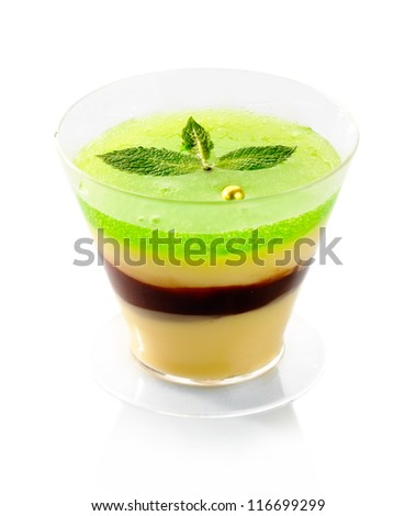 Fresh fruit jelly with green mint isolated on white background - stock photo