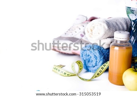 Fresh fruit juice and fitness accessories. Healthy lifestyle concept - stock photo