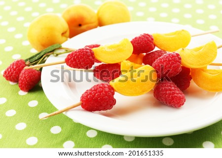 Fresh fruit kebabs for healthy snack on plate close up
