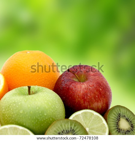 Fresh fruit on a blurred green background - stock photo