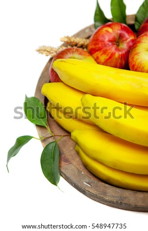 Fresh fruit on old wooden plate on a wooden background. Healthy concept. Organic food.