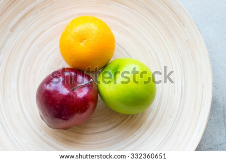 Fresh fruit on wood plate