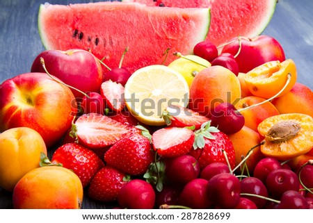 fresh fruit on wooden table - stock photo