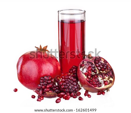 fresh fruit pomegranate isolated on a white background with pomegranate juice in the glass - stock photo