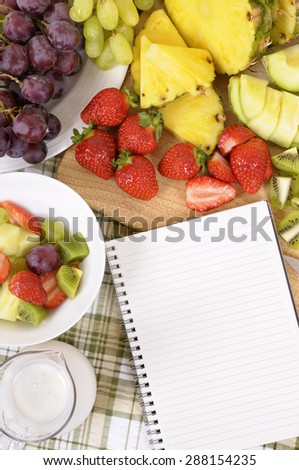 Fresh fruit salad collection, recipe book, white copy space, vertical - stock photo