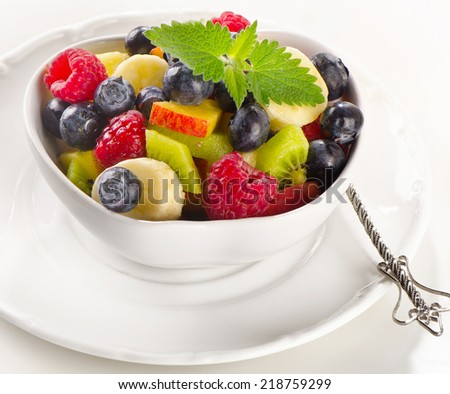 Fresh  fruit salad in a white bowl. Selective focus