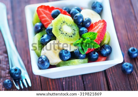 fresh fruit salad in the white bowl - stock photo