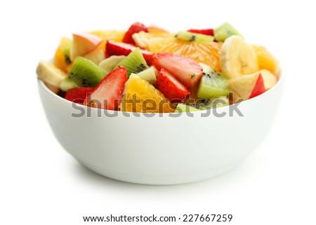 Fresh fruit salad isolated on white - stock photo
