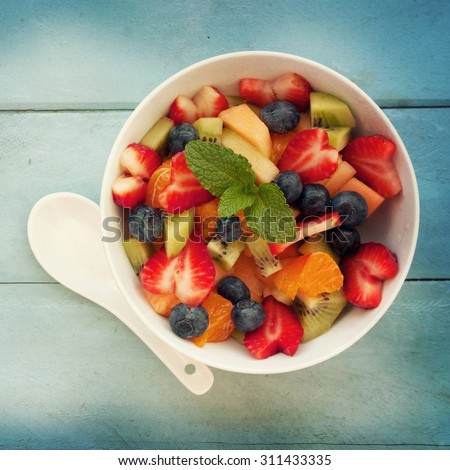 Fresh fruit salad on the table - stock photo