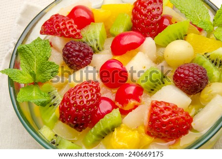 Fresh fruit salad served in a bowl - stock photo