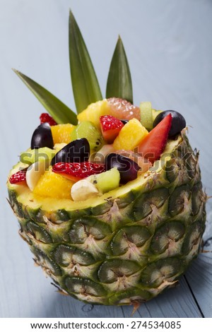 Fresh fruit salad served in bowls with fresh pineapple - stock photo